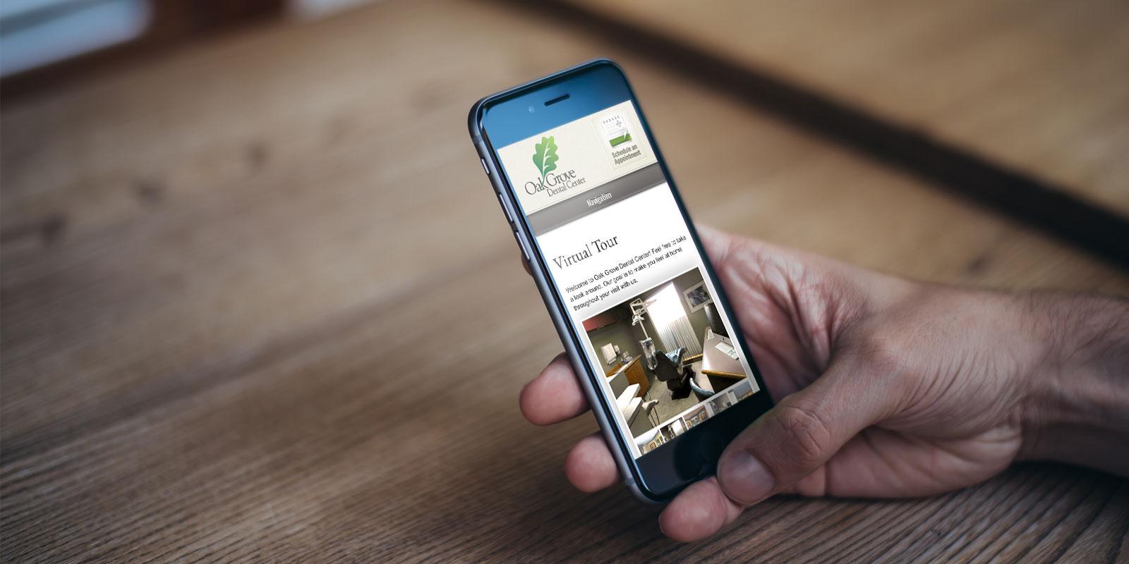 Oak Grove Dental Center website on a smartphone