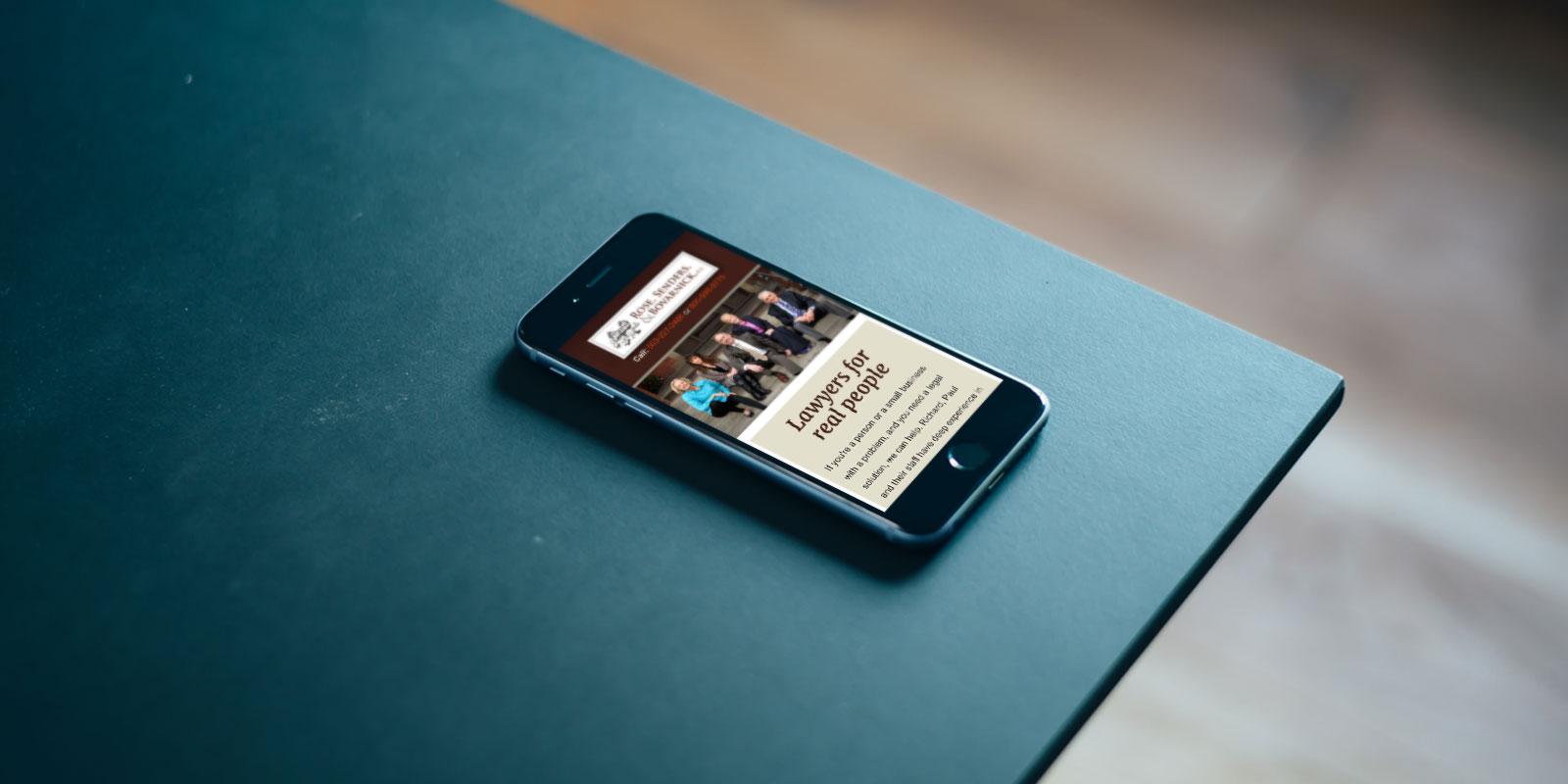 Rose, Sender, and Bovarnick website on a phone